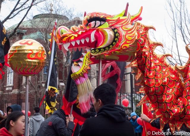 The dragon dances past a synagogue