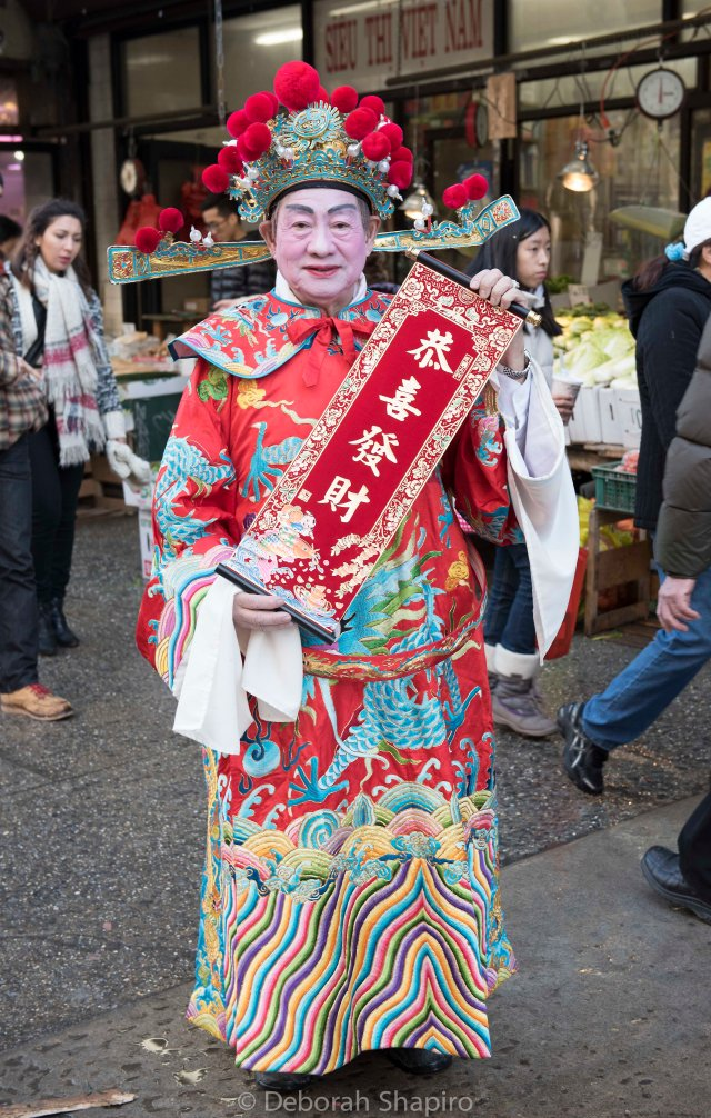 Chinese Opera singer with New Year wishes